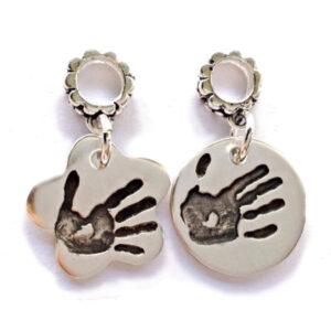 Flower shaped or circular handprint charms