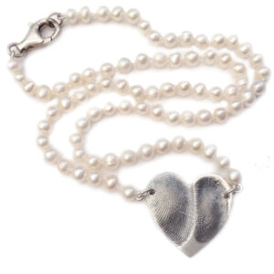 Medium double fingerprint heart strung on fresh water pearls