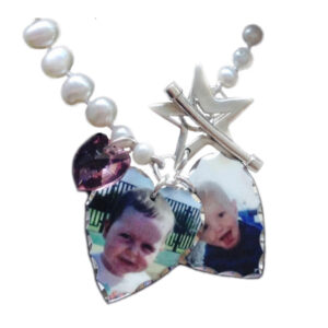 Photo heart charms on a fresh water pearl bracelet with silver star clasp and Swarovski crystal
